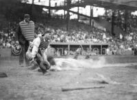 New York Yankee Lou Gehrig slides into home plate