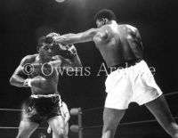 Muhammad Ali throwing punch at Floyd Patterson