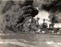 Battleship Row on fire Pearl Harbor